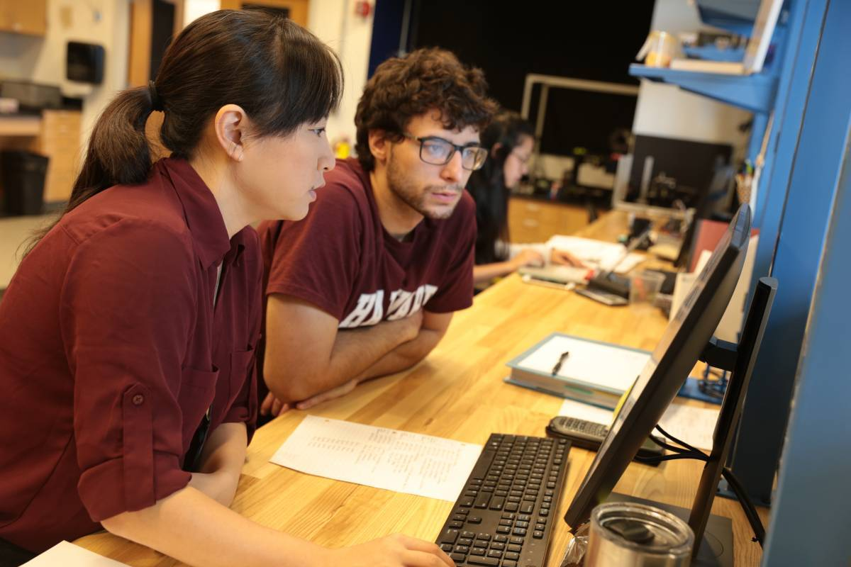 Mazumdar coaches a student in the Sensing Technologies Laboratory.